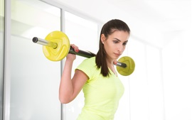 Preview wallpaper Fitness girl, yellow dress, workout, dumbbell