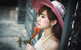 Lovely Asian girl, hat, violin