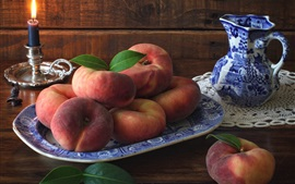 Preview wallpaper Peaches, candle, leaves, fruit photography
