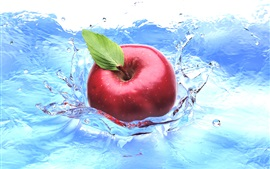 Red apple falling in water, splashes