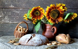 Preview wallpaper Still life, dry bread, sunflowers, vase, cookies