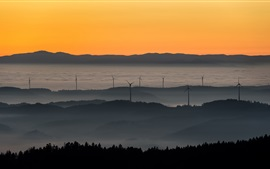 Preview wallpaper Sunset, windmills, fog, mountains, sky