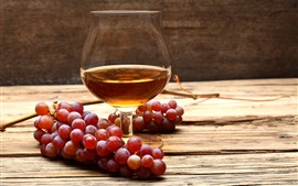 Preview wallpaper Wood table, red grapes, glass cup, wine