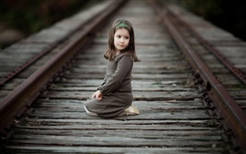 Preview wallpaper Cute little girl sit at railroad, child, look back