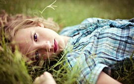 Preview wallpaper Girl lying on grass, blonde, face