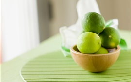 Preview wallpaper Green lemon, lime, bowl