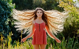Hair flying, red dress girl