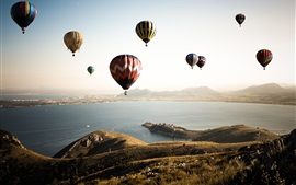 Hot air balloons, sky, sea