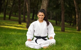 Preview wallpaper Karate, white clothes girl, smile, grass