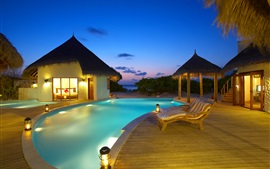 Maldives, resort, sunbeds, pool, huts, sea, evening