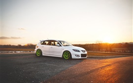 Mazda 3 white car at sunset