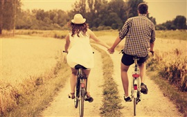 Retro style, girl and boy, lovers, bike, back view