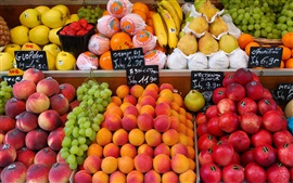 Street market, fruits shop, plums, peaches, grapes, pears, bananas, oranges
