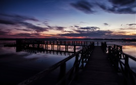Preview wallpaper Sunset pier, lake, clouds, dusk