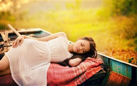 Preview wallpaper White dress Asian girl sleeping in the boat