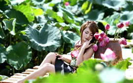 Asian girl and pink lotus