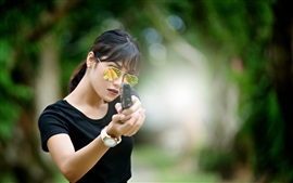 Preview wallpaper Black dress girl use gun, glasses