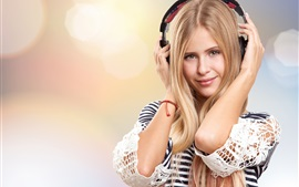 Blonde girl listening music, headphones