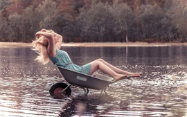 Preview wallpaper Blonde girl sit in small cart, water, lake