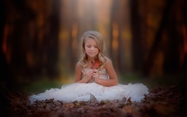 Preview wallpaper Blonde little girl, sit on the ground, white skirt, leaf, autumn