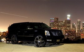 Cadillac black car side view, city, night