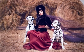 Dalmatians, lady and two dogs