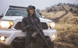 Preview wallpaper Girl use assault rifle, car, light