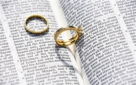 Gold rings, jewelry, book