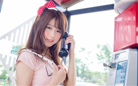 Preview wallpaper Lovely Asian girl use telephone