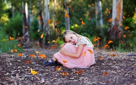 Preview wallpaper Lovely little girl sit on ground, autumn, leaves