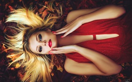 Preview wallpaper Makeup girl, hairstyle, blonde, lying on ground, autumn