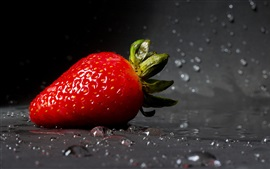 One strawberry close-up, water droplets