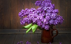 Purple lilac flowers, vase