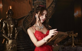 Red dress Asian girl reading a book