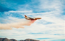 Aircraft flying in the sky, smoke, clouds
