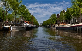 Preview wallpaper Amsterdam city views, river, boats, trees, clouds