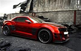 Chevrolet Camaro Guyver vista lateral carro esporte vermelho