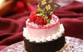 Preview wallpaper Chocolate cake, cream, red berries