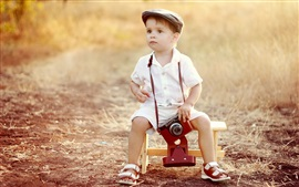 Preview wallpaper Cute little boy use camera