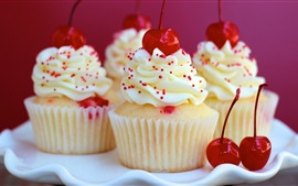 Delicious cupcakes, cream, dessert, red cherries