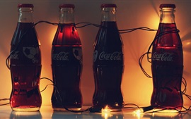 Preview wallpaper Four bottles Coca Cola, drinks
