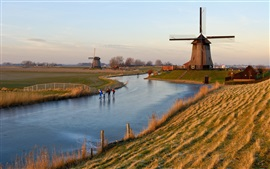 Holland, windmill, frozen river, grass