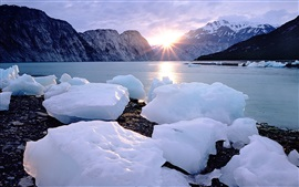 Preview wallpaper Ice cubes, snow, coast, sea, sunset, mountains