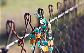 Jewelry on fence