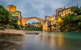 Preview wallpaper Mostar, Bosnia and Herzegovina, river, bridge, houses, lights, dusk