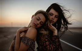 Two girls in the wind