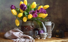 Yellow and purple tulips, vase, cup, still life