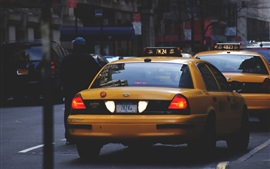 Preview wallpaper Yellow taxi, rear view, street