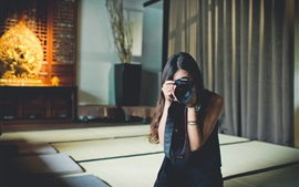 Asian girl use Canon camera