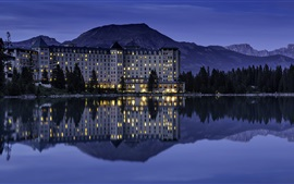 Preview wallpaper Banff National Park, hotel, lake, water reflection, mountains, lights, night, Canada